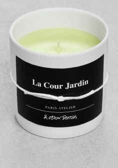 French 'La Cour Jardin' is named after the garden courtyard in our Paris store. Captivating white frangipani and sheer gardenia unveil the scent of the garden, revealing hopes of sandalwood and dreams of cardamom.  Our collection of scented candles is created in collaboration with renowned New York-based perfumer Jérôme Epinette of Roberte.