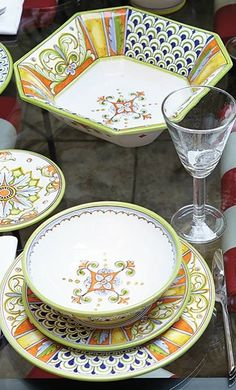 Pour yourself a glass of fine wine and set the table for an authentic Italian dining experience with these beautiful, handpainted ceramics from Deruta.