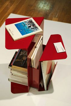 The folded steel side table from Martin Konrad Gloeckle combines a book shelf, side table and magazine rack into one piece.