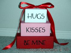 This is super easy; it just takes wood, paint, vinyl lettering and ribbon. Great Valentine's Day decoration too!