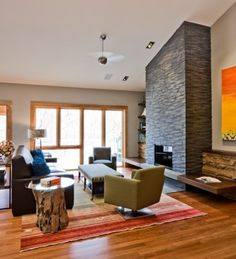 like the floating hearth and interesting material on wall