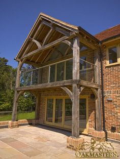 Traditionally crafted oak extension with beautiful balcony. Traditionally crafted oak extension with beautiful balcony. Oak Framed Extensions, House Extensions, Barn House Plans, New House Plans, Cottage Extension, Modern Family House, Oak Framed Buildings, Oak Frame House, House With Balcony