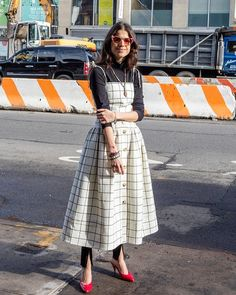 Leandra Medine wears Rejina Pyo Issy Check Wool Strap Dress. Available on Style.com.