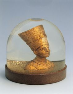 Close-up of a figurine of Egyptian queen Nefertari in a snow globe