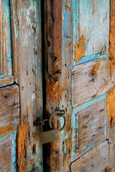 I love the painted doors you see in pictures of greece - all the layers and next to polished stone; very pretty