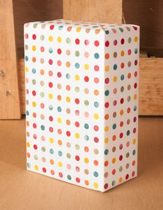 This is our colorful watercolor dotted pattern gift wrap. Each dot is a textred little gem of color, creating a beautiful wrap. A great pattern