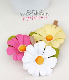 Super Cute paper daisy clips! You could clip these to a gift for someone!
