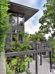 Terraces frame the main and lower levels of the house   archdigest.com
