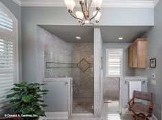 This master shower features custom tile work. The Chesnee home plan #1290