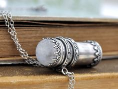 sterling silver container necklace, pill box, tube locket, moonstone necklace, message bottle necklace, long chain, rainbow moonstone by junesnight on Etsy https://www.etsy.com/listing/257557840/sterling-silver-container-necklace-pill