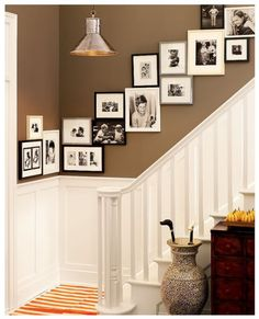 What a wonderful stairway #gallerywall that even wraps around the corner for an even more interesting look!