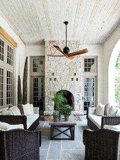Outdoor Room with Fireplace. Outdoor Fireplace. Back Porch. The ceiling wood in this porch is pecky cypress finished with Limewash and consolidated with Roma velatura. Beth Webb Interiors.