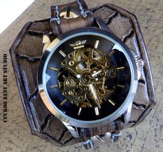 Brown hand tooled bracelet watch. This watchband is combined with a mechanical steampunk watch face. The wrist watch is made with veg tanned