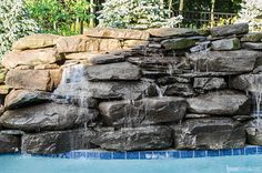 Waterfall adds interest to a swimming pool