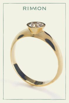 The perfect Gold Halo Engagement Ring. Modern and unique 18K solid gold ring, tapered band set with a white and clear diamond, designed to be stacked or worn alone. #engagement #engagementring #gold
