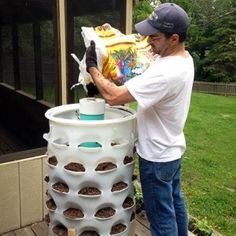 #VerticalGardening Garden Tower Project. There is a vertical planter with a worm tower in the center - you add kitchen scraps into the center tower which creates a compost tea that drips out the bottom which you add back into the plants. Each hole grows can grow a different plant.
