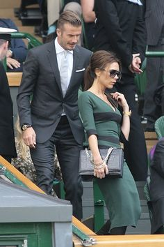 Victoria Beckham (in a dress of her own design!) and her hunky hubby David Beckham looking super-classy at Wimbeldon.