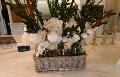 Instead of using only red and green for the holidays, white flowers, cotton and dark greenery gives the kitchen's white marble counter top an elegant Christmas accent in the Atlanta Christmas House 2012.