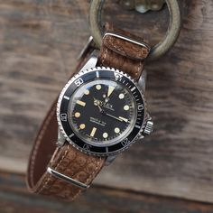 """Pure and simple...the beautiful Rolex 5513 Submariner, courtesy of @wannabuyawatch Los Angeles. Featured on my custom hand distressed 1.0mm thin brown…"""