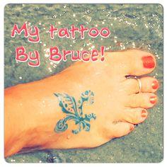 Fluer de lis tattoo in turquoise!