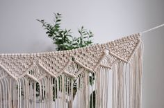 Macrame banner made with soft cotton rope. Will look great on wall or as a fireplace decor.  This macrame garland is trendy home decor, adds your interior boho look. Macrame wall hangings is also perfect for cute nursery or kids room. MADE IN ORDER in 3-5 business days  >> color: natural cotton/ecru/beige/linen  >> measurements: Length of hanging rope is approx. 110cm/ 43inch  Macrame height - 42cm/ 16.5 inch (with tassel) length- 64cm/ 25 inch   &gt...