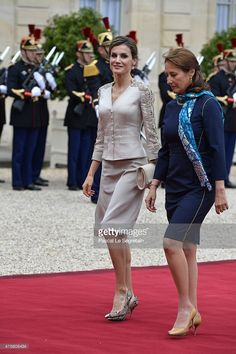 French Minister of Ecology Segolene Royal and Queen Letizia of Spain arrive in the courtyard of the Elysee Palace during day 1 of the Spanish Royal couple's state visit on June 2, 2015 in Paris, France. Spain's King Felipe VI and Queen Letizia are on a three-day state visit, which had to be postponed last march following the Germanwings plane crash.