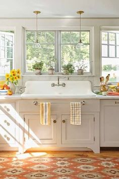 Cottage Kitchen with European Cabinets, Hardwood floors, Calacatta carrara, Pendant light, One-wall, Complex marble counters