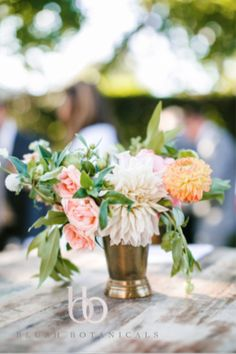 adorable cocktail hour centerpiece in peach tones.  photo by Josh Elliot Photography
