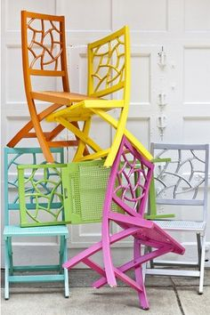Colorful garden chairs. Love the design & idea of bright pops of color outside.