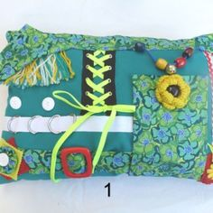 Green rectangle fiddle cushion with floral print