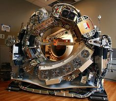 The inside of a CT scanner (CAT scan machine) shown here without its cover panels in place.