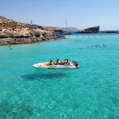 My own photo of the blue lagoon in Comino island, Malta. The water is so clear the boats appear to float on air! Was there today!