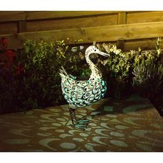 Smart Solar Metal Silhouette Duck. Charged in the day by a integral solar panel, this Metal Silhouette Duck automatically comes on at dusk and can last up to 6 hours. It has one white and one colour changing LED, and an on/off switch. Looks great on any patio, decking or patio, as the metal sculpture creates a stunning effect on the floor. ONLY £22.99!