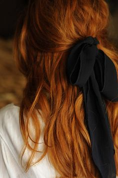 red hair, messy half-updo tied with beautiful ribbon.