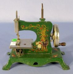 red riding hood Casige sewing machine. I have one of these, so worn, you can only see some green. I love it!