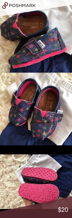 {toms} tiny toms slip on star sneakers Excellent condition. No stains, tears, or holes.  •No reserves/holds •I bundle & discount bundles •If an item is higher than you want to pay, message an offer  •Usually ships within 24 hrs and latest 48 hours unless otherwise noted. #toms #tinytoms Toms Shoes Sneakers