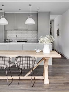 Colouring concept...grey bench tops, mid tone laminate flooring, white subway tiles, white pendant lights