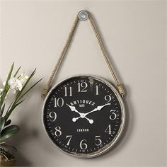 Own a replica ship's clock! The Uttermost Bartram Wall Clock features a rope handle like the clocks once used on sailing vessels; these clocks. Hanging Clock, Rustic Loft, Industrial Loft, Black Clocks, Shabby, Decorative Hooks, Matte Black, Modern