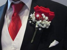 Red rose boutonnière with the stem wrapped in damask print for the groom!