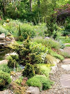 Rock garden ideas. Here, a row of rocks   separates the hillside garden filled with a mixture of plants -- including   purple coneflower, geranium, daylily, and sedum -- from an informal pathway. The   rocks along the garden's edge lend definition while complementing the rustic   nature of the rock garden.