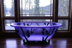 Purple glass claw-foot tub