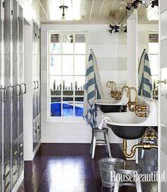 Beach house bath.  Locker-style storage + kohler brockway sinks with brass fittings + two-tone planking + walnut floors | Erin Martin Design