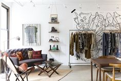 The relaxed showroom is rich with collected objects Dougherty sourced from all over, each one representative of the Suno brand. A framed dress from the first collection graces the wall above the sofa...