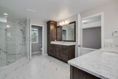 Owner's Suite: Ceramic tile floors, granite counter tops, dual vanities, stained cabinets, matching ceramic tile shower with glass door