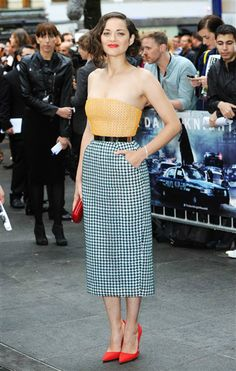 "The always stylish Marion Cotillard mixed prints with bold colors the London premiere of ""The Dark Knight Rises."" See more celebs on Wonderwall. http://on-msn.com/NcZaMy"