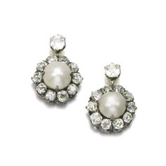 PROPERTY FROM THE ESTATE OF MARY, DUCHESS OF ROXBURGHE: Pair of natural pearl and diamond earrings, late 19th century. Each set with a button shaped natural pearl framed and on a surmount set with cushion-shaped and circular-cut diamonds.