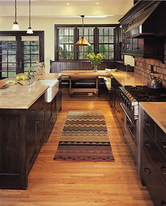 Beautiful kitchen.  Love the dark wood cabinets.