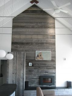 Recycled Wood on Fireplace.. Unfortunately I do not have a fireplace but doing this to one of the walls would look neat ..