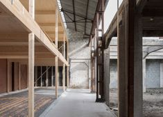 WK 2 | This industrial building was shelled and new wooden homes were built inside. WHY NOT USE THE EXISTING STRUCTURE