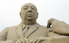 Detail of a sand sculpture of Alfred Hitchcock is seen as pieces are prepared as part of this years Hollywood themed annual Weston-super-Mare Sand Sculpture festival on March 26, 2013 in Weston-Super-Mare, England.